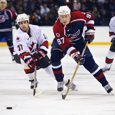 Jeremy Roenick (R) of theUSA moves the puck before